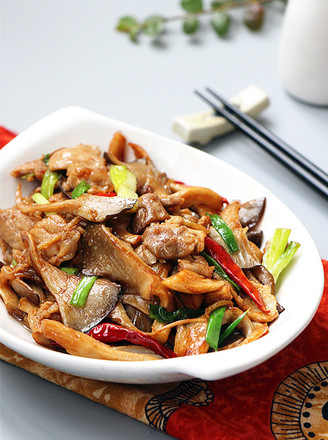肉片炒鲜蘑的做法
