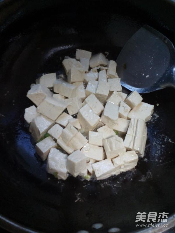 金针菇海鲜炖豆腐怎么吃