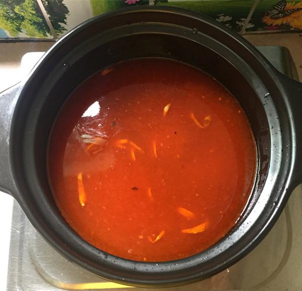 红酸汤三文鱼头鸭血煲怎么煸