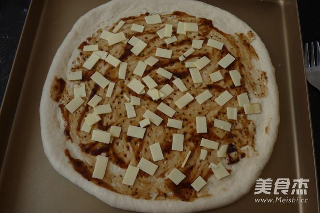 黑椒羊肉披萨怎么吃