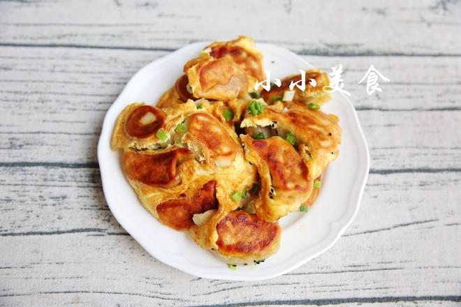 蛋抱煎饺:蛋香浓郁的金灿灿饺子成品图