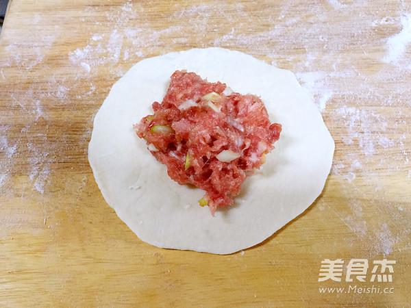 烫面肉饼怎么吃