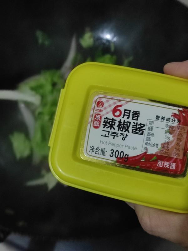 辣白菜肉丝年糕汤怎么炒